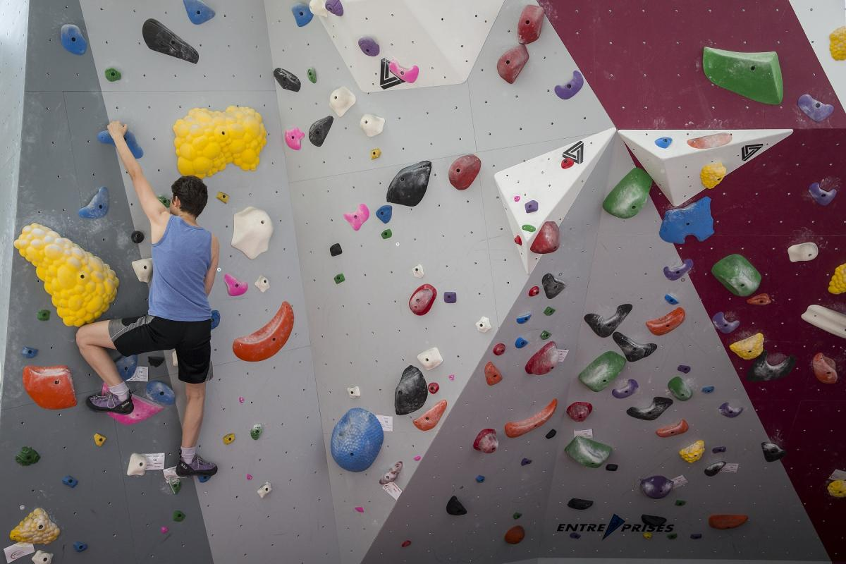 Student climbing on the climbing wall