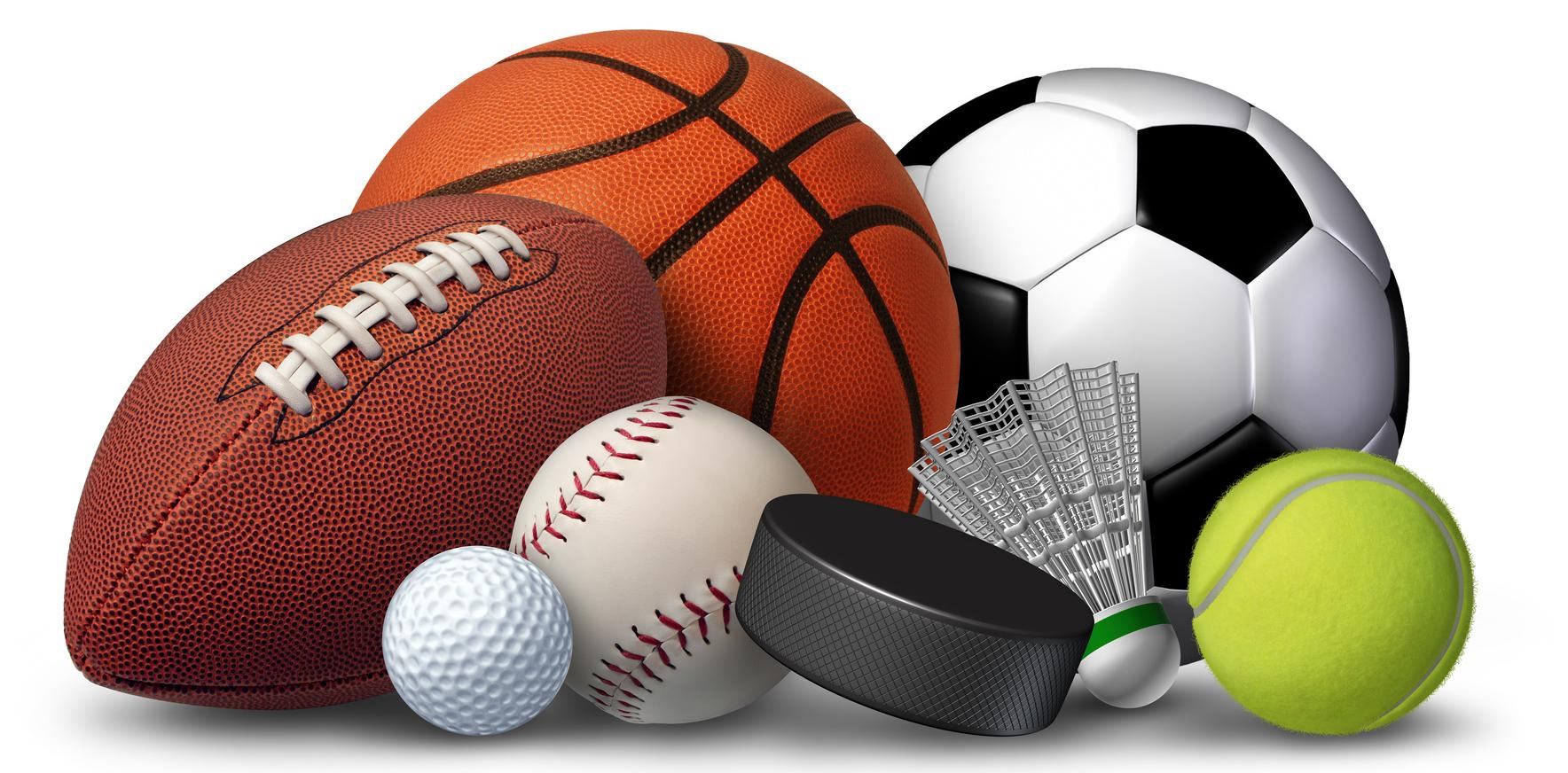 A variety of athletic balls including football, basketball and soccer ball
