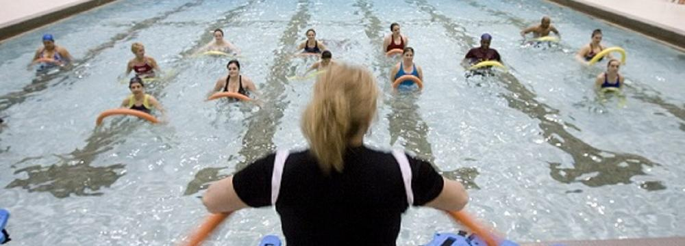 Participants exercising in the water aerobics session