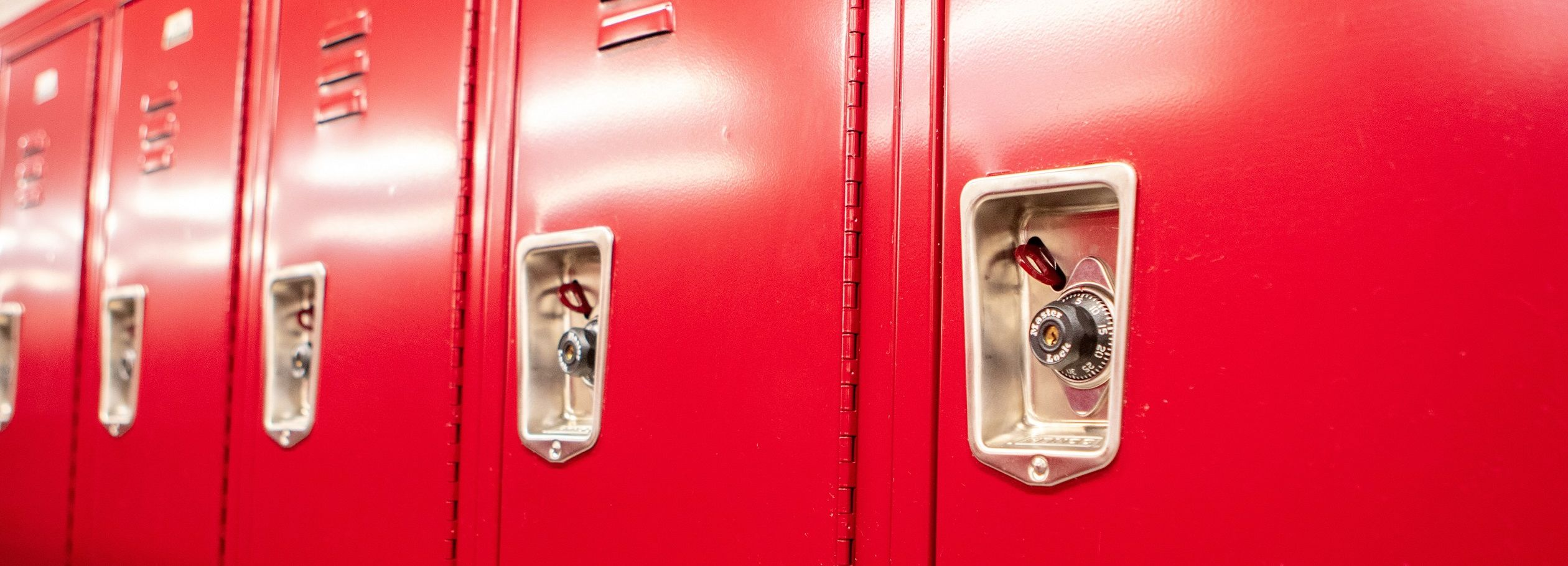 A close up of the red lockers in Pearson and McGonigle Halls.