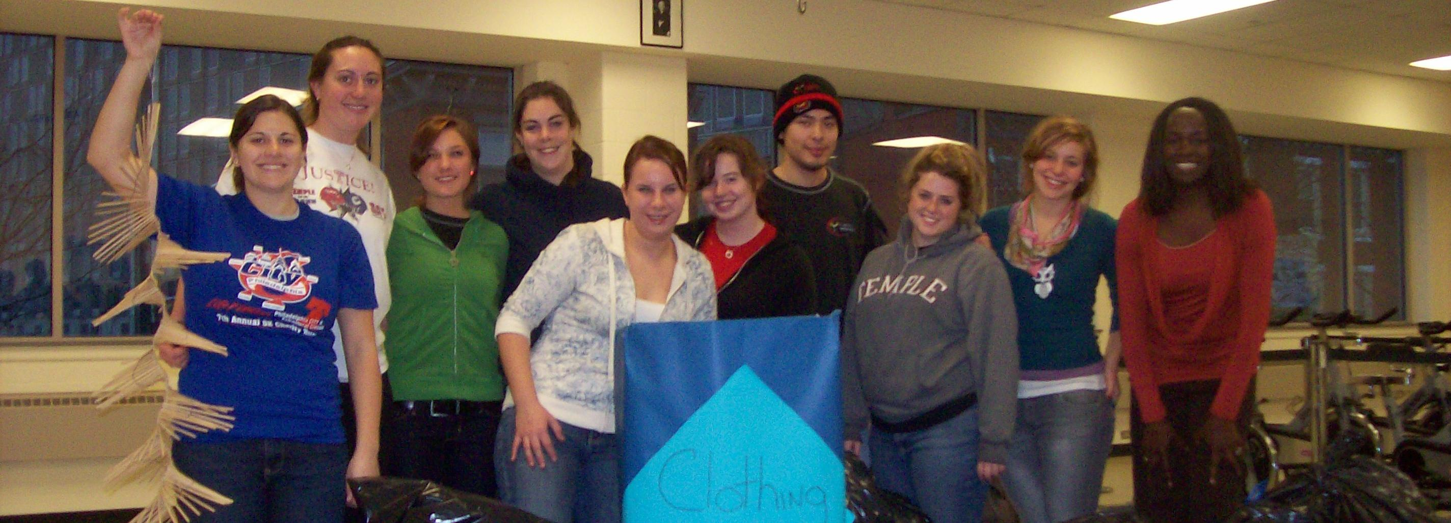 Students and staff assisting with a clothing drive