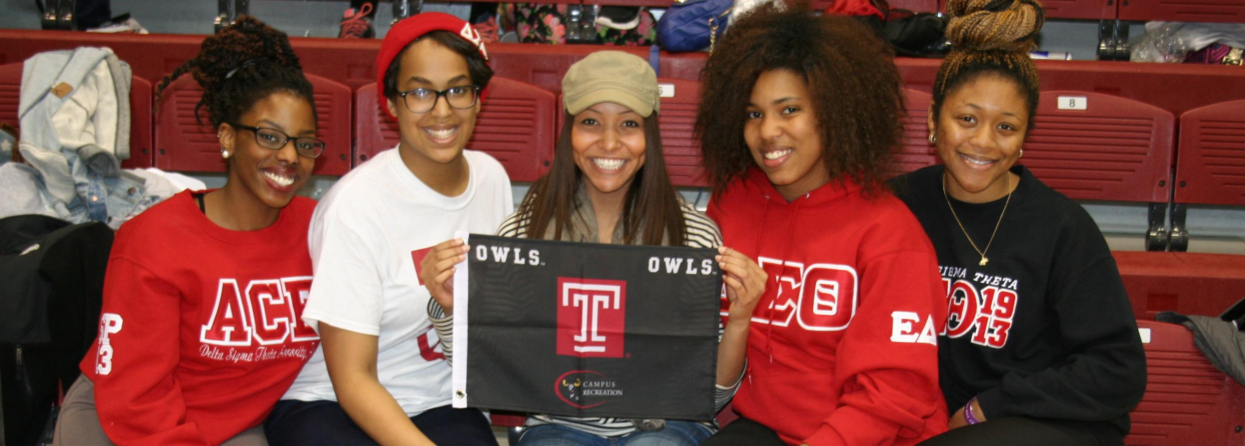 Students holding Campus Rec Flag