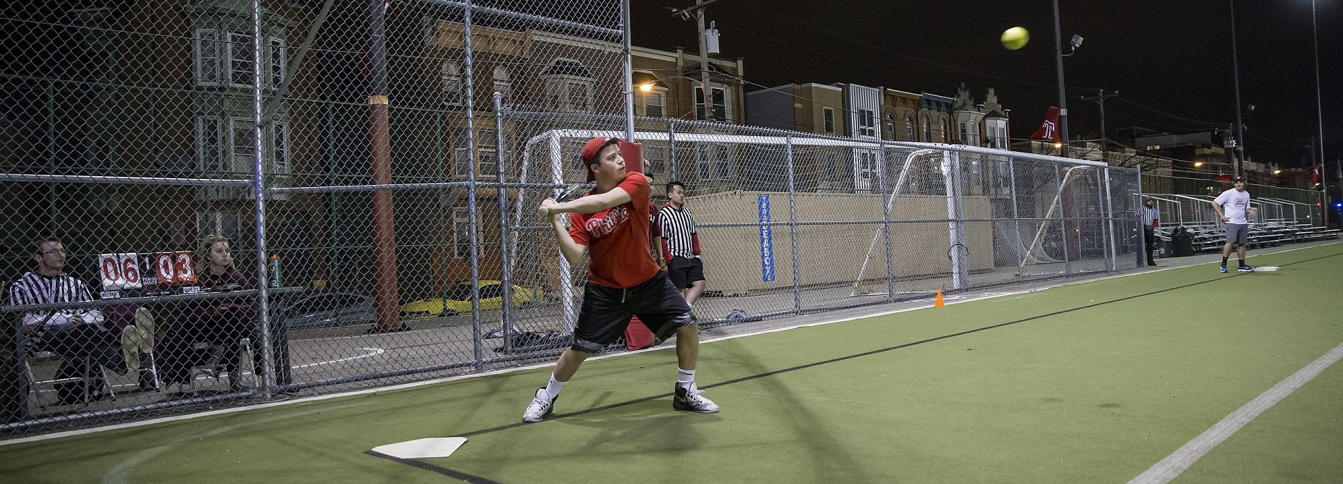 A batter prepares to swing at an incoming pitch.