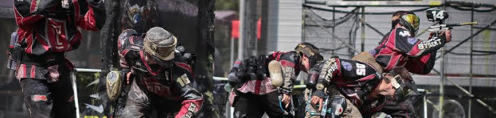 Action shot of the Temple University Paintball Club lined up and starting a competition.