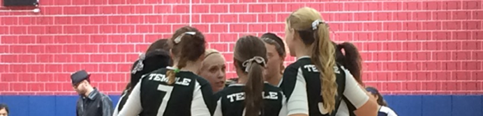 Temple University Women's Volleyball Club huddled up on the court.