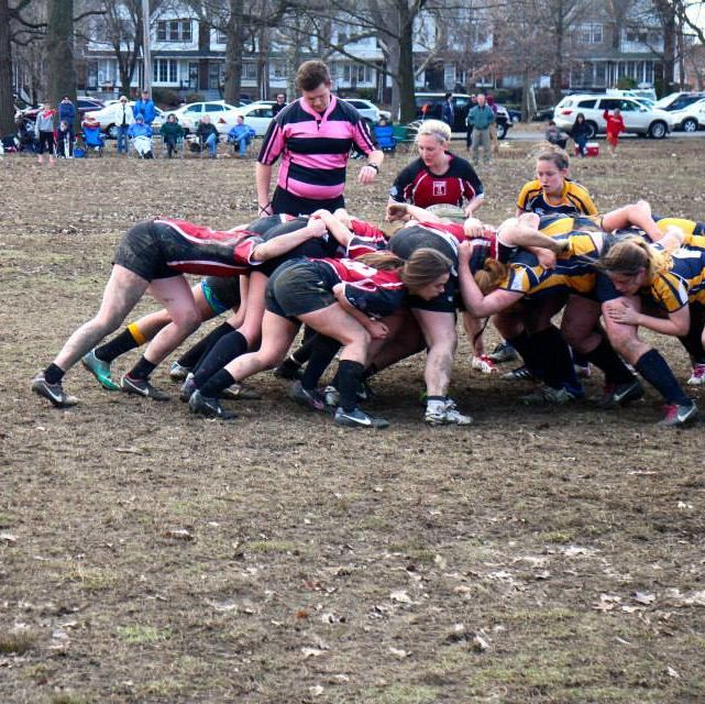 Temple University Women's Rugby in action during a game.