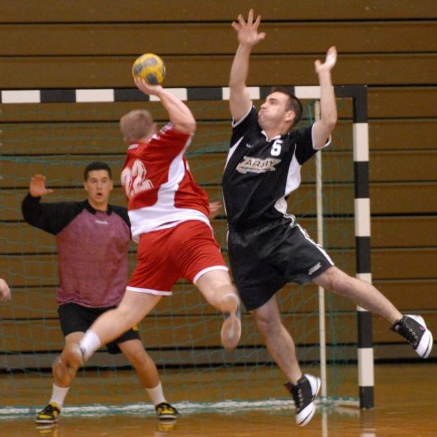 players looking to score a goal in team handball
