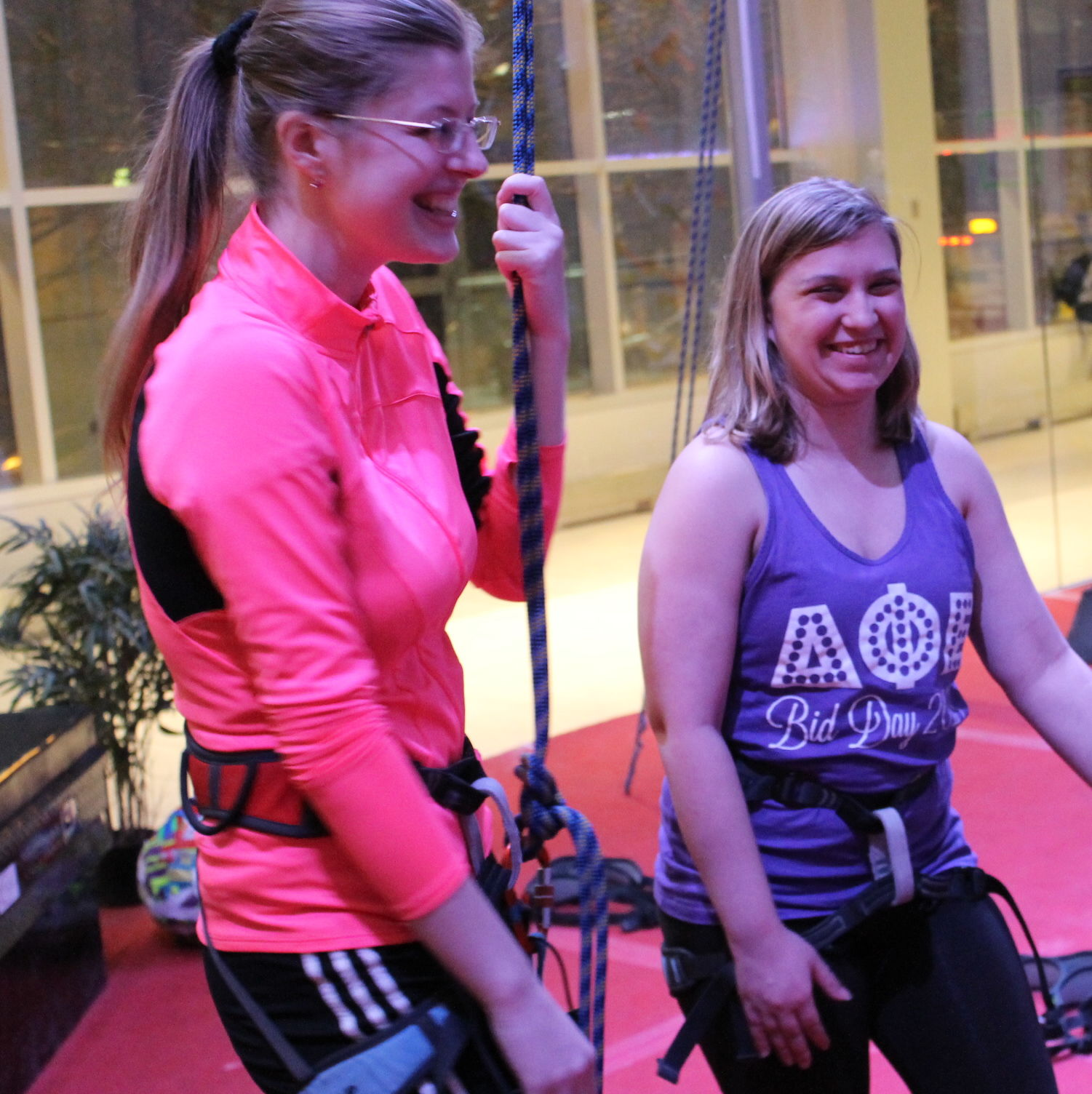 Students during belay class at the climbing wall