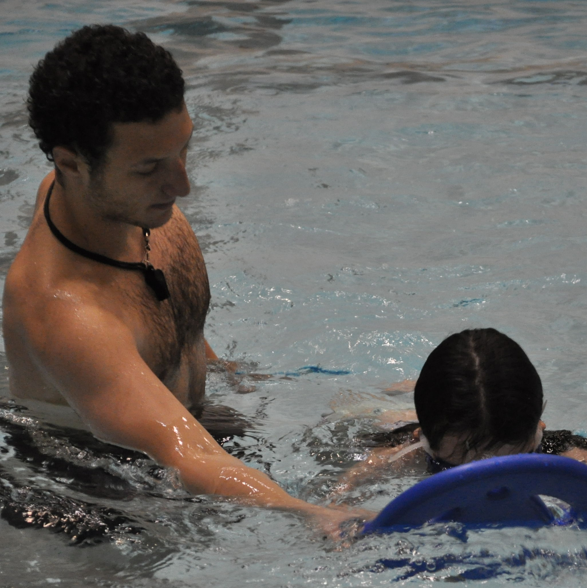 Learn to swim instructor teaching student
