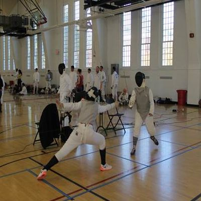 Two fencers in competition