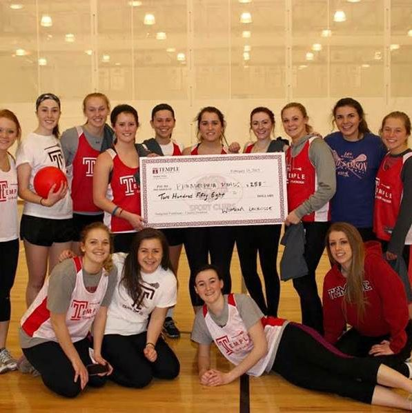 Club posing after winning Dodgeball Fundraiser with giant check