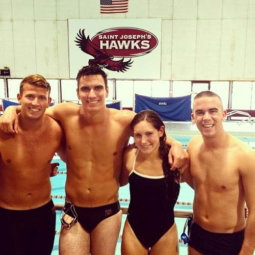 Four Temple University Swimming Club members.