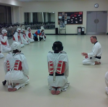 Temple University Taekwondo Club sitting during a lesson.