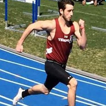 Temple University Men's Track Club member running a race.