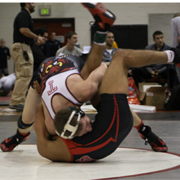 Temple University Wrestling Club member wrestling an opposing club member.