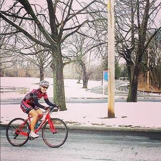 Lone cyclist on a snowy day