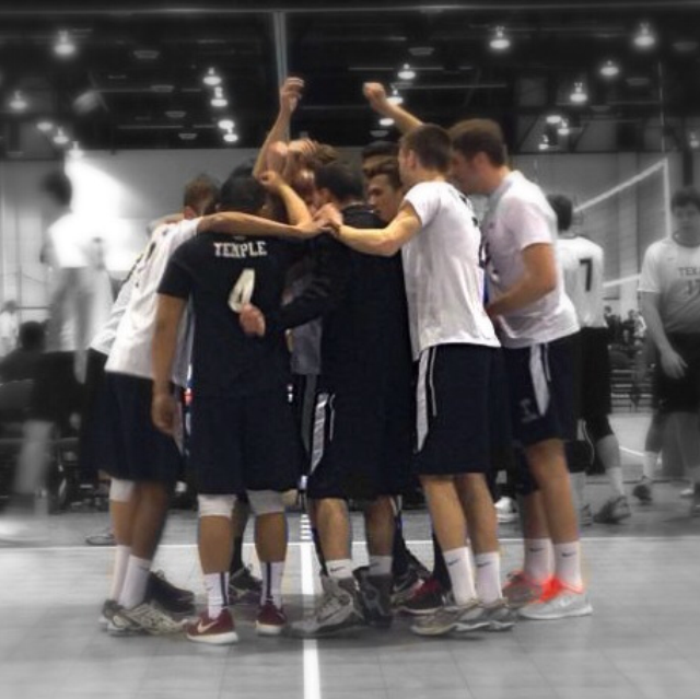 Temple University Men's Volleyball Club huddled up on the court.