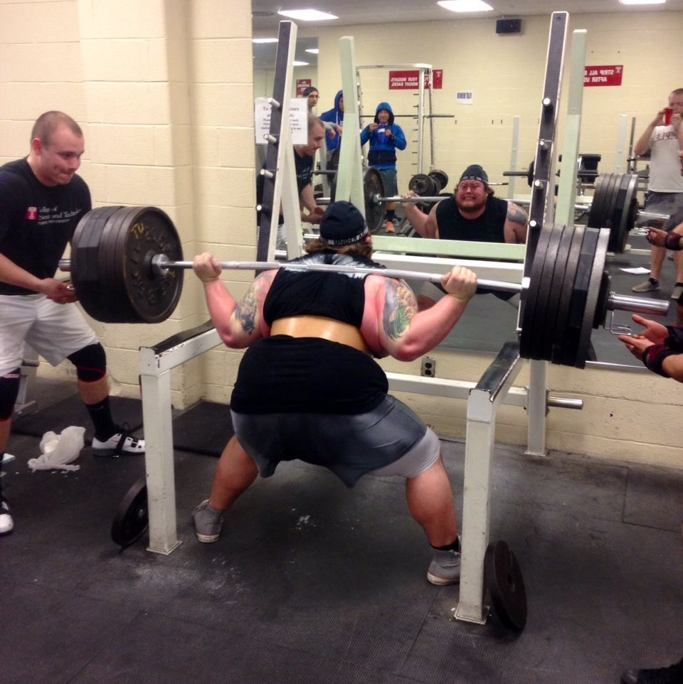 Temple University Powerlifting Club member lifting during a competition.