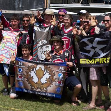 Temple University Paintball Club group picture holding up their sponsorship banners as well as their 3rd place banner from